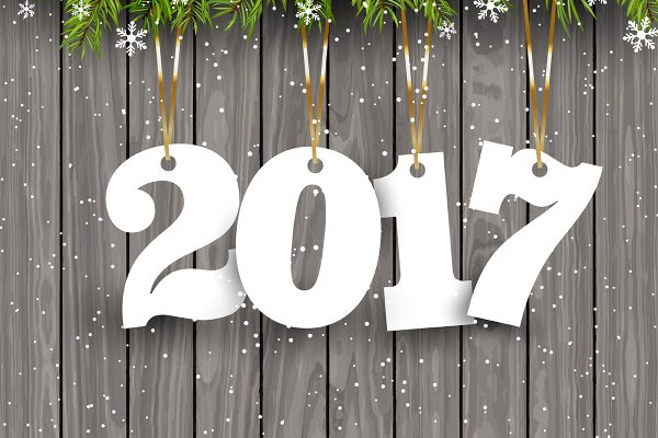 Happy New Year background with hanging numbers on a snowy wood background
